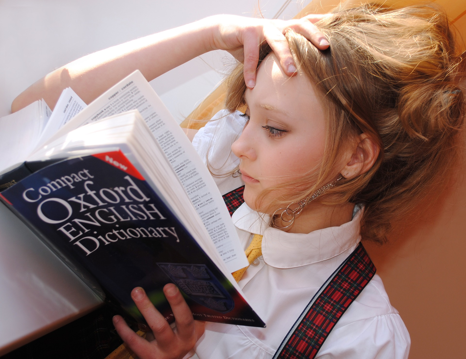 Girl looking in dictionary